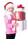 Lyckliga lilla ungar som slitage Santas hatt Fotografering för Bildbyråer