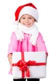 Lyckliga lilla ungar som slitage Santas hatt Royaltyfri Foto