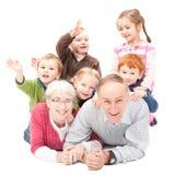 Lyckliga morföräldrar med grandkids Arkivbilder