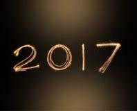 Lyckliga nya år 2017 fyrverkerignistrandealfabet lyckligt nytt år för begrepp Fotografering för Bildbyråer