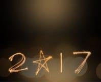 Lyckliga nya år 2017 fyrverkerignistrandealfabet lyckligt nytt år för begrepp Royaltyfria Foton