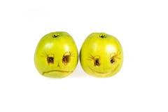 Lyckliga och ledsna emoticons från äpplen Känslor, inställningar och sinnesrörelser Fotografering för Bildbyråer