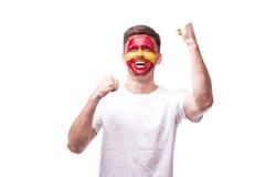 Lyckliga och målskrisinnesrörelser för seger, av den Spanien fotbollsfan Arkivfoton