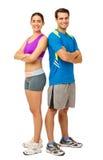 Lyckliga par i sportkläder Royaltyfri Fotografi