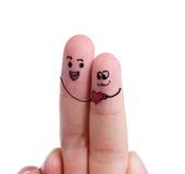 Lyckliga par som är förälskade med målad smiley Royaltyfri Foto