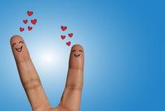 Lyckliga par som drömmer av förälskelse - förälskelsebegreppsillustration genom att använda fingrar Fotografering för Bildbyråer