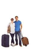 Lyckliga par som går på ferie Royaltyfria Foton