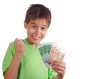 lyckliga pengar för pojke Royaltyfria Foton