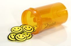 lyckliga pills royaltyfria bilder