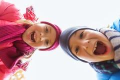 Lyckliga pojke- och flickaframsidor Fotografering för Bildbyråer
