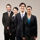 lyckliga posera dräkter för co som slitage arbetare Royaltyfri Fotografi