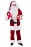 Lyckliga Santa Claus med giftboxes Arkivfoton