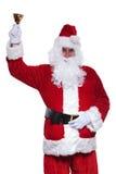 Lyckliga Santa Claus ringer hans lilla klocka Arkivbilder