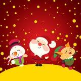 Lyckliga Santa Claus, snögubbe och älva Arkivbilder
