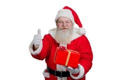 Lyckliga Santa Claus som ger upp tummen Royaltyfri Foto