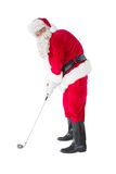 Lyckliga Santa Claus som spelar golf Royaltyfria Foton