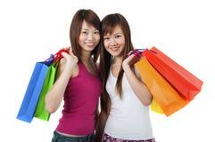Lyckliga shoppare Fotografering för Bildbyråer