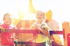 Lyckliga små flickor på barnlekplats Fotografering för Bildbyråer