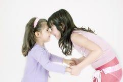 lyckliga systrar Arkivbilder