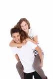 Lyckliga tonåringar som på ryggen rider Royaltyfri Fotografi