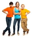 Lyckliga tonårs- ungar Arkivbild
