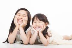 Lyckliga två asiatiska flickor Royaltyfria Foton