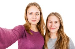 Lyckliga unga systrar Arkivbild