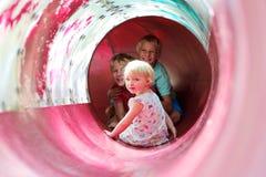 Lyckliga ungar som har gyckel i lekplatsen royaltyfri foto