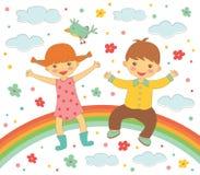 Lyckliga ungar som sitter på regnbågen Fotografering för Bildbyråer