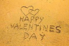 Lyckliga valentin dag - i strandsanden Fotografering för Bildbyråer
