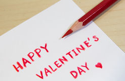 Lyckliga valentin dagformuleringar med färgblyertspennan Fotografering för Bildbyråer