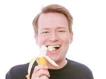 Lyckligt äta för banan Arkivbilder