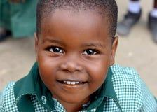Lyckligt afrikanskt skolbarn Fotografering för Bildbyråer