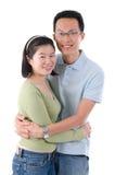lyckligt barn för asiatiska par Arkivfoton