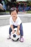 Lyckligt barn med fotboll royaltyfri fotografi