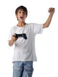 Lyckligt barn med styrspaken som spelar videogames Fotografering för Bildbyråer