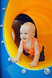 Lyckligt barn på lekplatsen Fotografering för Bildbyråer