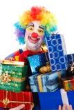 Lycklig clown med gåvor Royaltyfria Bilder