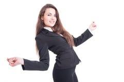 Lyckligt dansa för affärskvinna som är upphetsat och som är entusiastiskt Arkivfoto