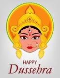 Lyckligt Dussehra hälsningkort Maa Durga Face för hinduisk festival Arkivfoto
