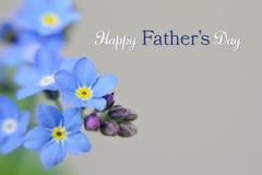 Lyckligt fader dagkort Blått blommar på ljus bakgrund Arkivbild