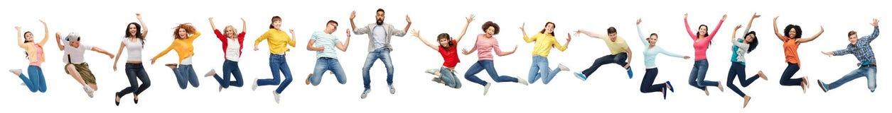 Lyckligt folk som hoppar i luft över vit bakgrund royaltyfria foton
