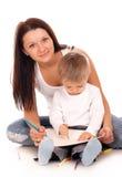 Lyckligt fostra med ett barn Fotografering för Bildbyråer