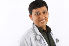 lyckligt indiskt barn för doktor Arkivbild