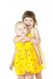 Lyckligt isolerat krama för ungar arkivfoto