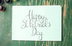 Lyckligt kort för St Patrick dagkalligrafi Royaltyfri Fotografi