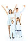 Lyckligt le för familj. Arkivbild