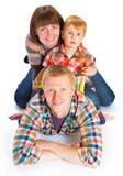 Lyckligt le för familjstående Fotografering för Bildbyråer