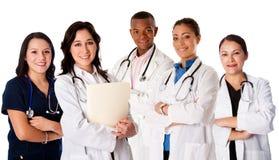 Lyckligt le lag för doktorsläkaresjuksköterska arkivfoto