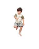 Lyckligt litet barn i vit kläder Arkivfoto